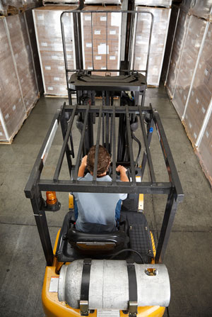 Picture of man working forklift.